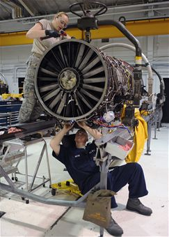 2_people_working_on_engine
